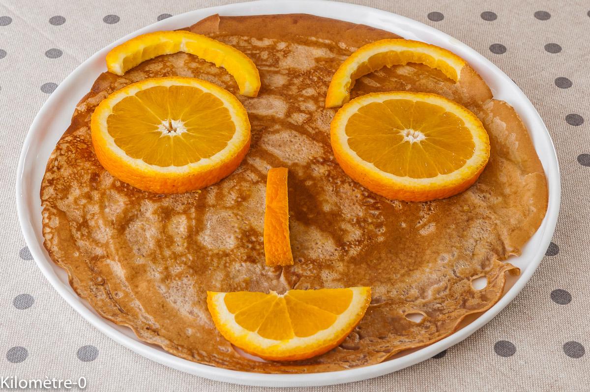 Photo de recette de crêpes marrantes, enfant, chandeleur, orange, bio de Kilomètre-0, blog de cuisine réalisée à partir de produits locaux et issus de circuits courts